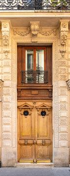 Paris, an ancient door, typical building in the 11e arrondissement