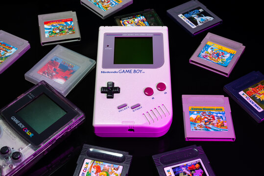 Fukuoka, Japan - september 19, 2021 : nintendo game boy and game boy color with various game cartridges isolated on black background