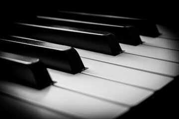 close up of piano keys in black and white