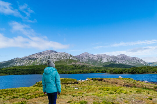 Woman looks at Mountain Lake Ireland