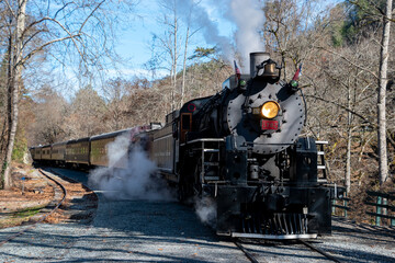 A steam powered locomotive on the train tracks in the Great Smoky Mountains