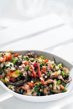 traditional greek Ktapodi octopus salad bowl on Athens restaurant table
