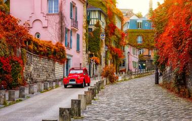 Fototapeta Cozy street in quarter Montmartre in Paris, France. Architecture and landmarks of Paris. Postcard of Paris obraz