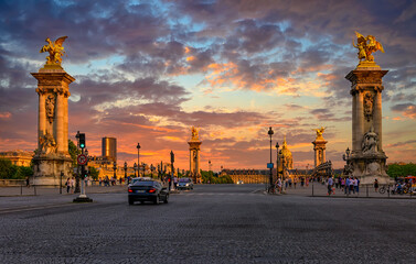 Fototapeta Pont Alexandre III bridge over river Seine and Hotel des Invalides on background at sunset in Paris, France.  Cityscape of Paris. Architecture and landmarks of Paris. obraz