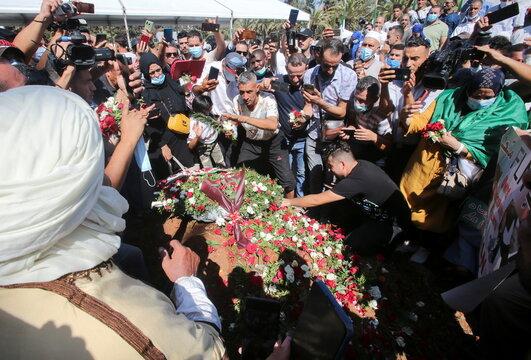 People gather at the burial site of former Algerian President Abdelaziz Bouteflika at El Alia cemetery, in Algiers