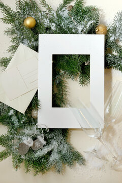 Christmas greeting card with fir tree in white frame