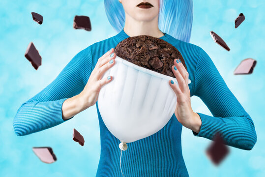 Woman with balloon chocolate muffin on a blue background