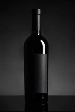 Bottle of wine on black background