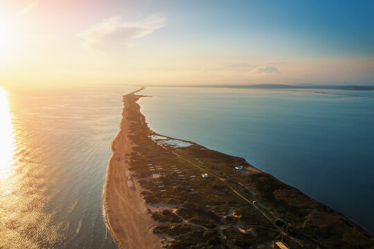 Long spit with beautiful sandy beach between sea and liman , aerial view from drone.