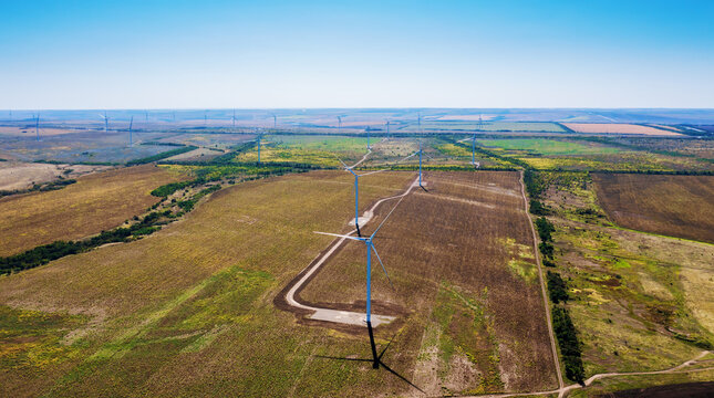 Wind turbine farm power generator aerial view. Production of renewable energy for future technologies