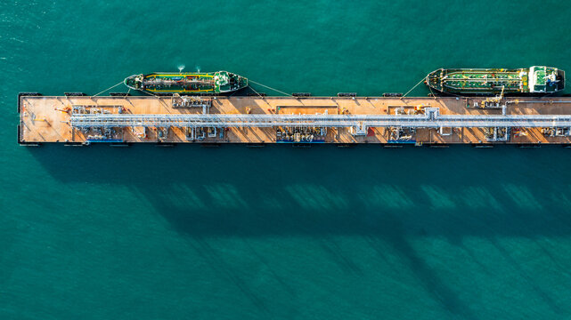 Aerial view industrial crude oil and fuel tanker ship at deep ocean sea port, Tanker ship vessel at terminal port, Business import export oil and gas petrochemical by tanker ship transportation oil.