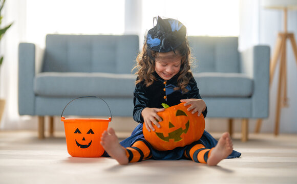 child with carving pumpkin