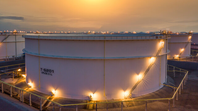 White Oil Tanks at sunset, White oil storage tanks, Big industrial crude oil tanks in refinery base industrial plant.