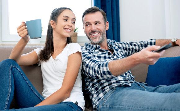 Couple watching TV on sofa