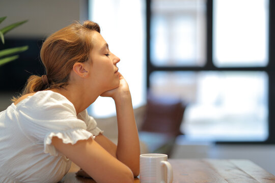 Woman meditating resting at home