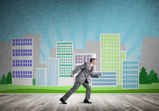 King businessman in elegant suit running and cityscape silhouette at background