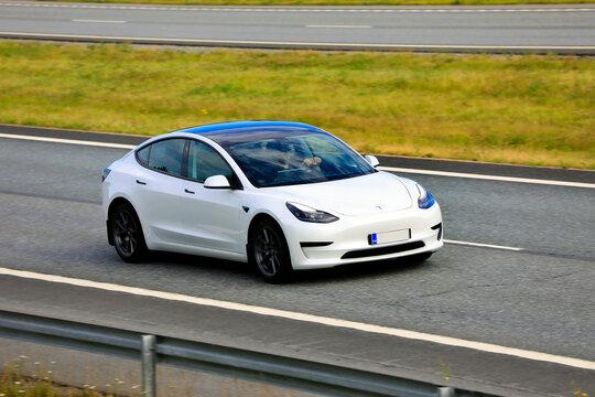 White Tesla Model 3 Electric Car on Motorway