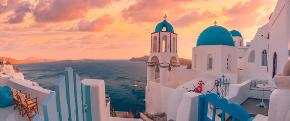 Fototapeta Panoramic summer destination. Traveling concept, sunset scenic famous landscape Santorini island, Oia, Greece. Caldera view, colorful clouds, dream cityscape. Vacation panorama, amazing outdoor scene obraz