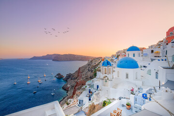 Europe summer destination. Traveling concept, sunset scenic famous landscape of Santorini island, Oia, Greece. Caldera view, colorful clouds, dream cityscape. Vacation panorama, amazing outdoor scene