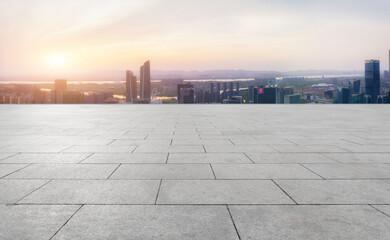 Fototapeta Panoramic skyline and empty square floor tiles with modern buildings obraz