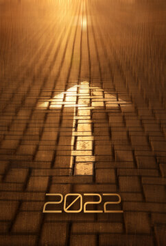 2022 New year and arrow on the road background. Forward New Year concept with arrow and 2022 number at sunset. Concept of planning, business, strategy, opportunity, goals, career and change