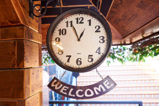 Vintage clock with welcome sign.
