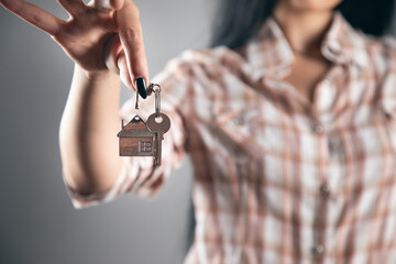 Fototapeta Real estate agents holding house key obraz