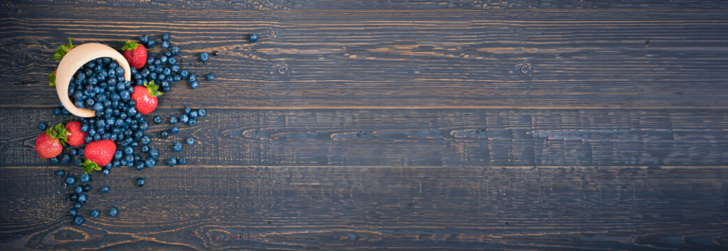 Fresh Berries on Rustic Wooden Background