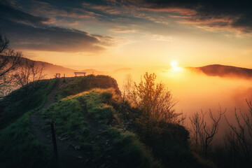 Beautiful sunrise in mountains with white fog