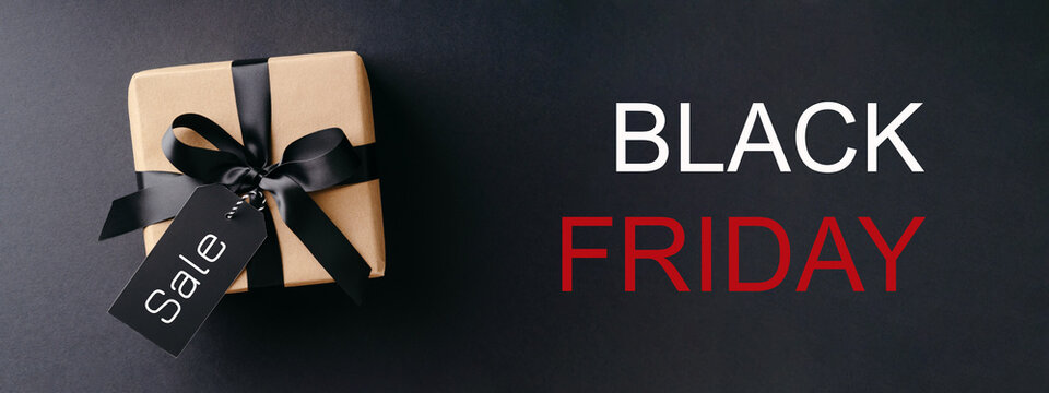 Black Friday banner with gift box on black background.