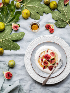 Plate of yogurt with figs viewed from above
