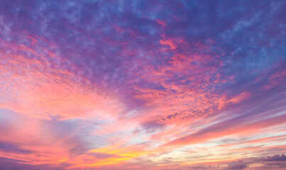 Fototapeta Flaming beautiful sunset background or replacement sky with pinks and organges and yellow and purple obraz