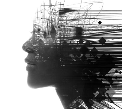 A double exposure portrait of a woman combined with digital art.Paintography