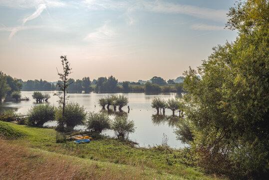 Floodplains of the Dutch river Waal. The photo was taken from the Waaldijk at the Herwijnense Bovenwaard near the village of Herwijnen, municipality of West Betuwe, Province of Gelderland.