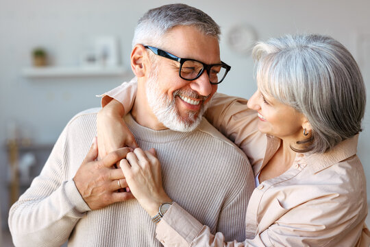 Beautiful smiling senior family couple husband and wife looking at each other with love