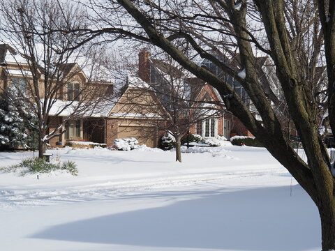 Fresh snow in suburban neighborhood.