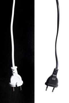 Two black and white european electricity plugs. Energy concept.