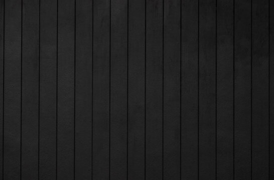 black wooden wall background and texture. dark vertical timber panel.