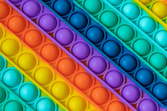 Rainbow Fidget Toys Pop it background and texture. Push Pop Bubble toy for kid.