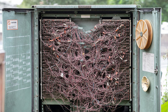 messi telephone lines wires in steel cabinet.