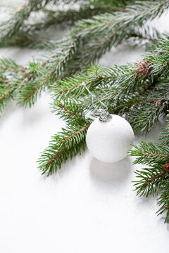 White  holiday decoration on green branch Christmas concept