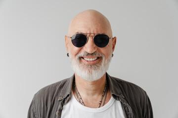 Fototapeta Bald european man in sunglasses laughing and looking at camera obraz