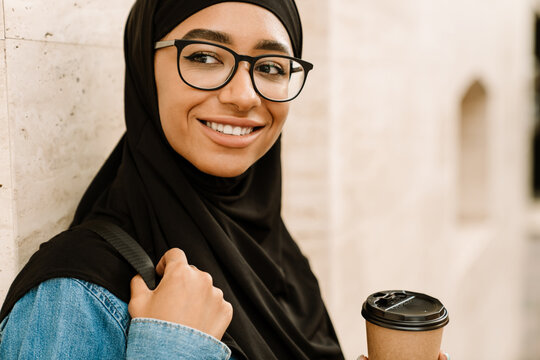 Close up of a smiling young muslim woman in hijab