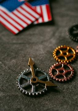 cogwheels, clock hands and american flags