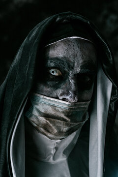 evil nun wearing a dirty face mask