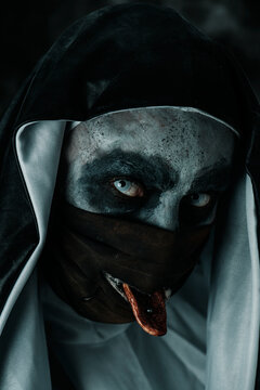 evil nun sticking out her pierced tongue