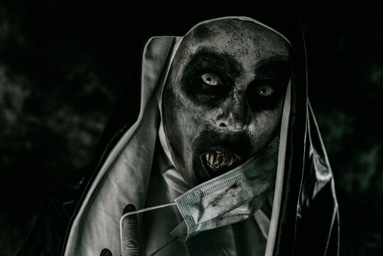 evil nun covering her mouth with a dirty face mask