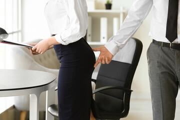 Fototapeta Boss touching butt of his secretary in office. Concept of harassment obraz