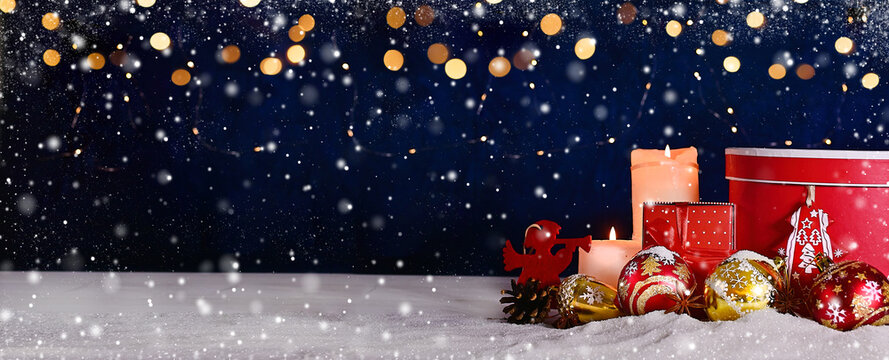 Advent- Christmas composition of ball, candles and ornaments. Christmas or New Year banner on a blue background with bright bokeh and snow