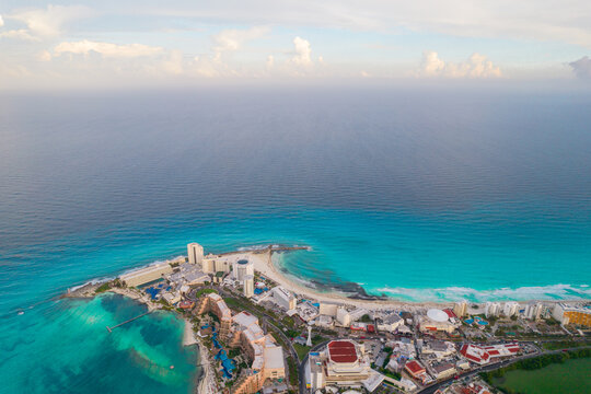 Aerial panoramic view of Cancun beach and city hotel zone in Mexico. Caribbean coast landscape of Mexican resort with beach Playa Caracol and Kukulcan road. Riviera Maya in Quintana roo region on